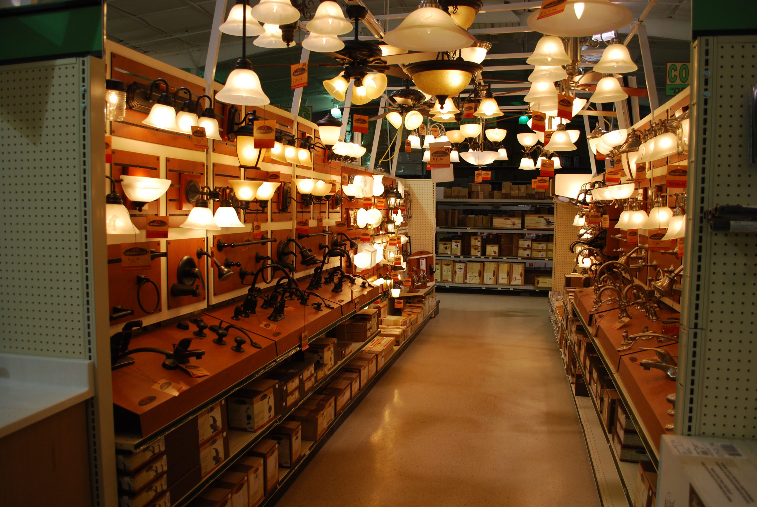 Hardware store aisle with light fixtures and product promotion