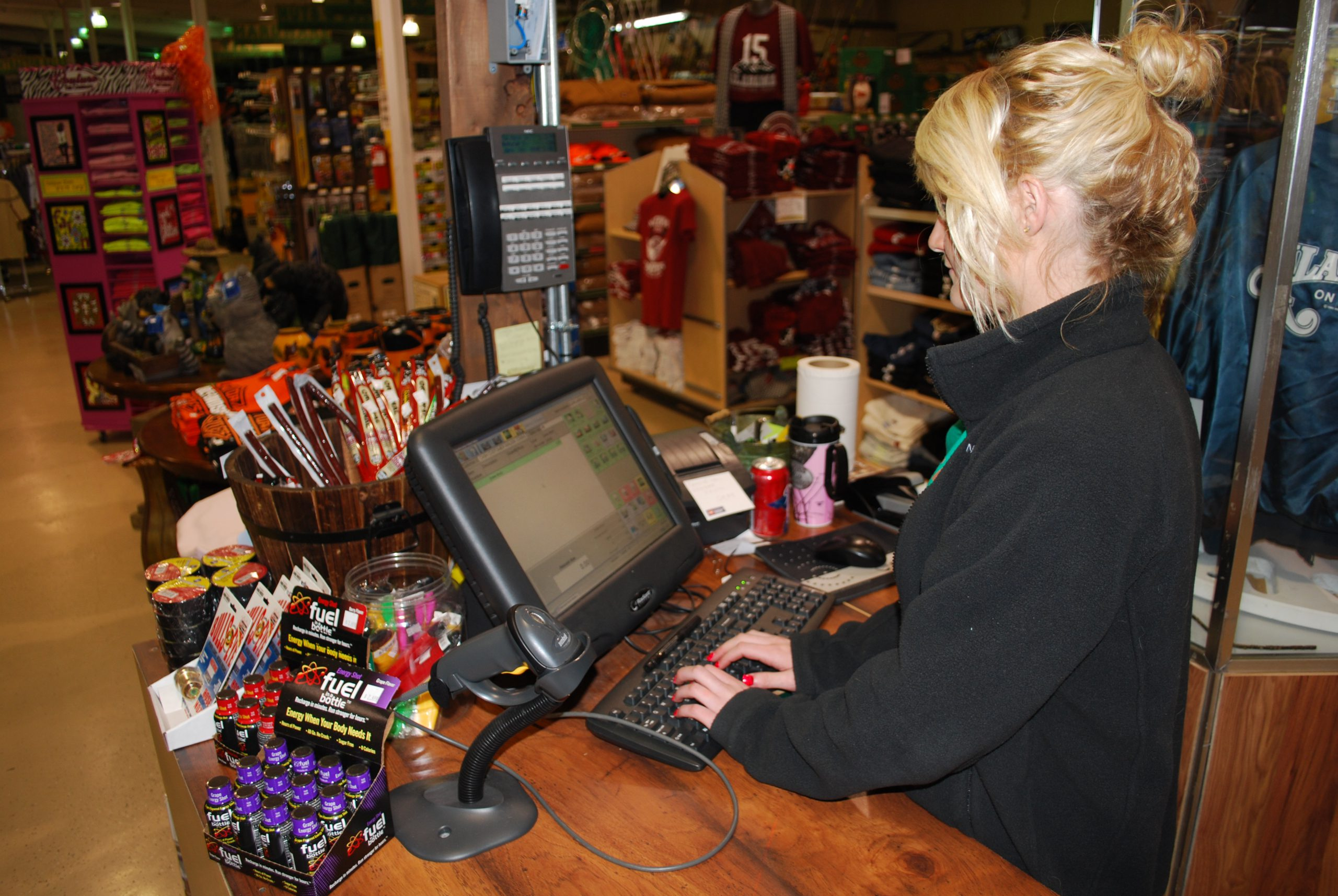 Hardware store employee using House-Hasson's point of sale system